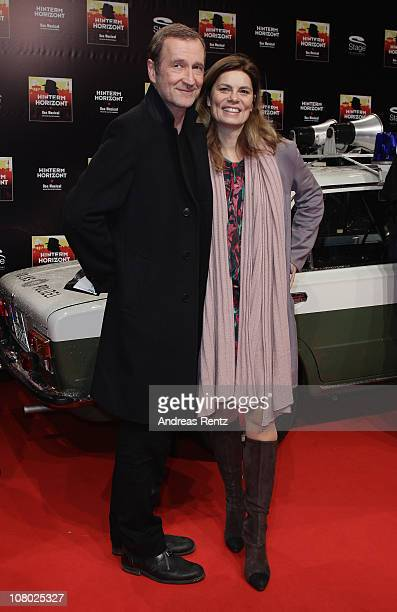 Peter Lohmeyer and Sarah Wiener arrive for the 'Hinterm Horizont' musical premiere at Theater am Potsdamer Platz on January 13 2011 in Berlin Germany