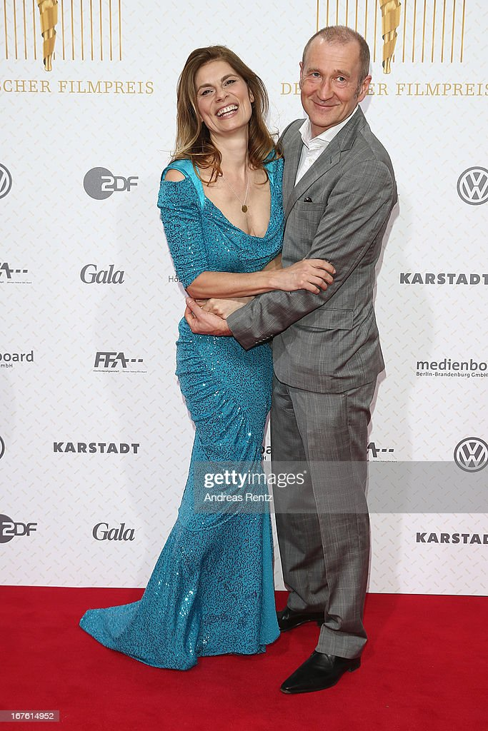 Peter Lohmeyer and Sarah Wiener arrives for the Lola - German Film Award 2013 at Friedrichstadt-Palast on April 26, 2013 in Berlin, Germany.