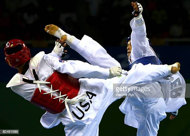 Peter Lopez of Peru competes against Mark Lopez of the United States in the Men 68kg Taekwondo Quarterfinals at the Beijing Science and Technology...