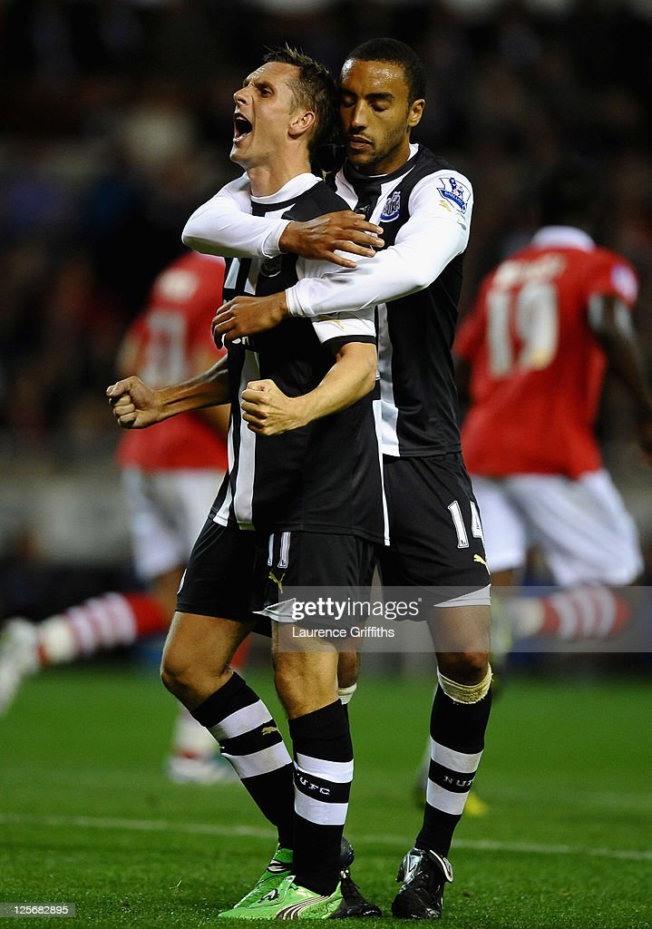 <a gi-track='captionPersonalityLinkClicked' href=/galleries/search?phrase=Peter+Lovenkrands&family=editorial&specificpeople=764734 ng-click='$event.stopPropagation()'>Peter Lovenkrands</a> of Newcastle United celebrates scoring his side's second goal from the penalty spot with team mate <a gi-track='captionPersonalityLinkClicked' href=/galleries/search?phrase=James+Perch&family=editorial&specificpeople=2211397 ng-click='$event.stopPropagation()'>James Perch</a> during the Carling Cup Third Round match between Nottingham Forest and Newcastle United at the City Ground on September 20, 2011 in Nottingham, England.