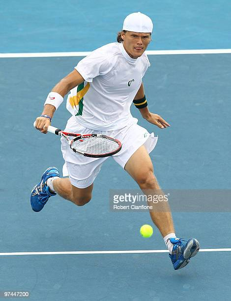 Peter Luczak of Australia plays a backhand in his match against ChuHuan Yi of Chinese Taipei during day of the Davis Cup AsiaOceania Zone Group 1 tie...