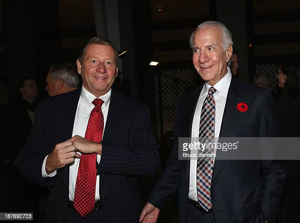 Peter Luukko and Ed Snider of the Philadelphia Flyers walks the red carpet prior to the 2013 Hockey Hall of Fame induction ceremony on November 11...