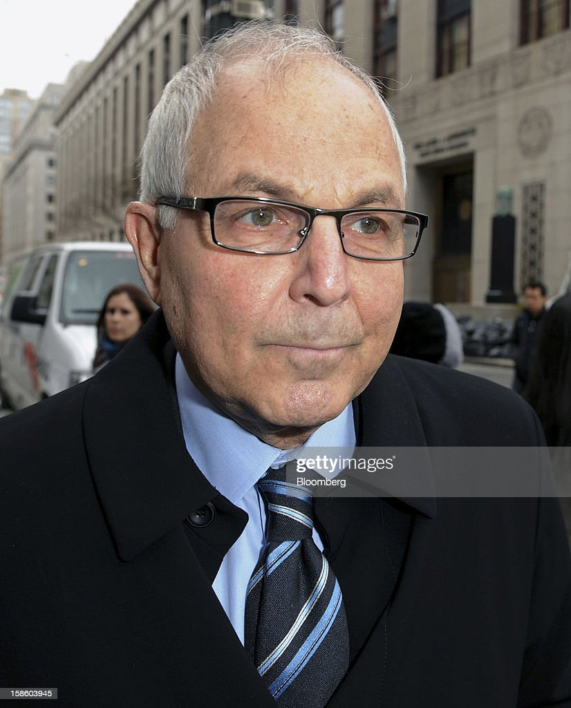 Peter Madoff, former chief compliance officer for his brother's firm, Bernard L. Madoff Investment Securities LLC, arrives at federal court for a sentencing hearing on Thursday, Dec. 20, 2012. Madoff, 67, who worked at Bernard L. Madoff Investment Securities LLC for four decades, pleaded guilty in June to helping his brother pull off the biggest Ponzi scheme in history. Photographer: Peter Foley/Bloomberg via Getty Images