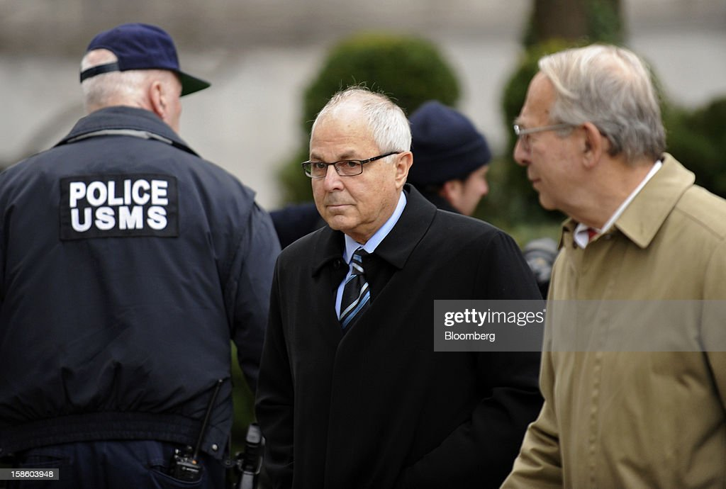 Peter Madoff, former chief compliance officer for his brother's firm, Bernard L. Madoff Investment Securities LLC, center, arrives at federal court for a sentencing hearing on Thursday, Dec. 20, 2012. Madoff, 67, who worked at Bernard L. Madoff Investment Securities LLC for four decades, pleaded guilty in June to helping his brother pull off the biggest Ponzi scheme in history. Photographer: Peter Foley/Bloomberg via Getty Images