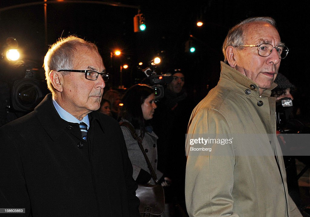 Peter Madoff, former chief compliance officer for his brother's firm, Bernard L. Madoff Investment Securities LLC, left, exits federal court on Thursday, Dec. 20, 2012. Madoff, who admitted aiding Bernard Madoff's fraud while claiming he didn't know his older brother was running a vast, decades-long Ponzi scheme, was sentenced to 10 years in prison. Photographer: Peter Foley/Bloomberg via Getty Images