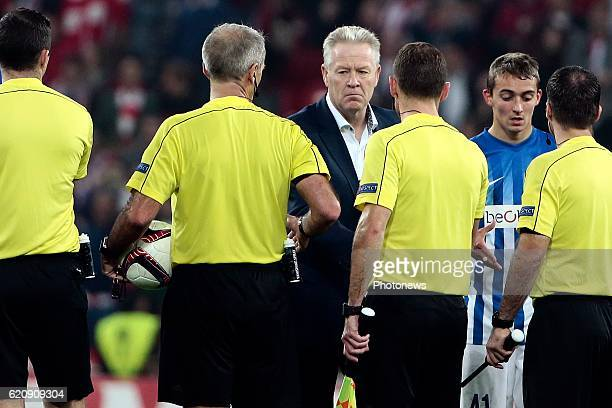 Peter Maes head coach of KRC Genk greets the referee Martin Atkinson and his assistants pictured during the UEFA Europa League group F stage match...