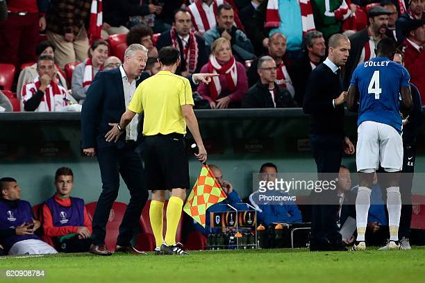 Peter Maes head coach of KRC Genk in discussion with the assistant referee pictured during the UEFA Europa League group F stage match between...