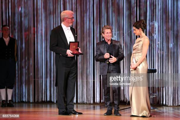 Peter Maffay get an award Linda Zervakis during the Semper Opera Ball 2017 at Semperoper on February 3 2017 in Dresden Germany