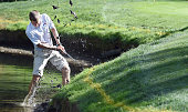 Peter Malnati attempts to hit out of the edge of a pond on the 12th hole during the first round of the WinCo Foods Portland Open on August 27 2015 in...
