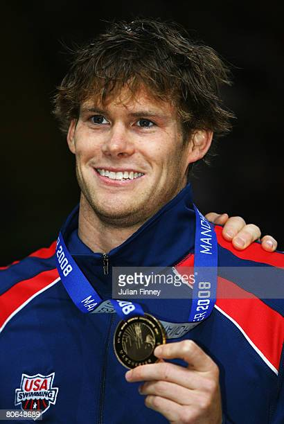 Peter Marshall of United States receives the gold medal in the Men's 50m Backstroke Final during the ninth FINA World Swimming Championships at the...