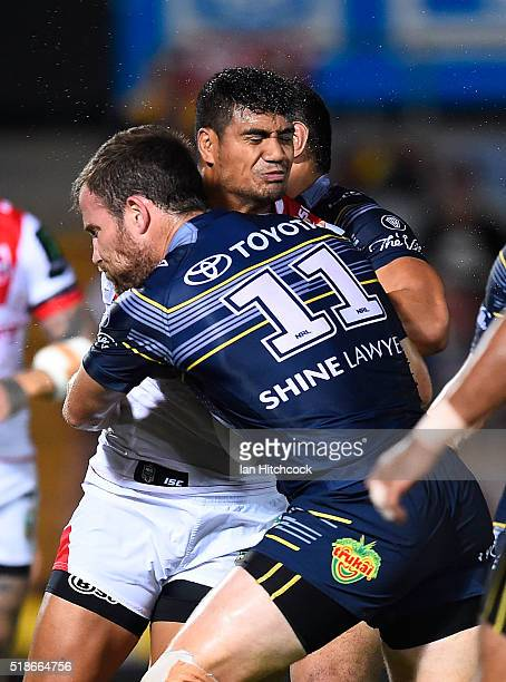 Peter Mata'utia of the Dragons is tackled by Gavin Cooper of the Cowboys during the round five NRL match between the North Queensland Cowboys and the...