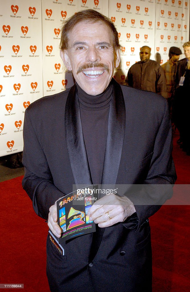 <a gi-track='captionPersonalityLinkClicked' href=/galleries/search?phrase=Peter+Max&family=editorial&specificpeople=228386 ng-click='$event.stopPropagation()'>Peter Max</a> during The 45th GRAMMY Awards - MusiCares 2003 Person of the Year - Bono - Arrivals by Jeff Kravitz at Marriott Marquis in New York City, New York, United States.
