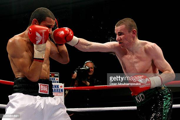 Peter McDonagh of Bermondsey throws and lands his punch on Curtis Woodhouse of Driffield in the LightWelterweight bout at York Hall on October 23...