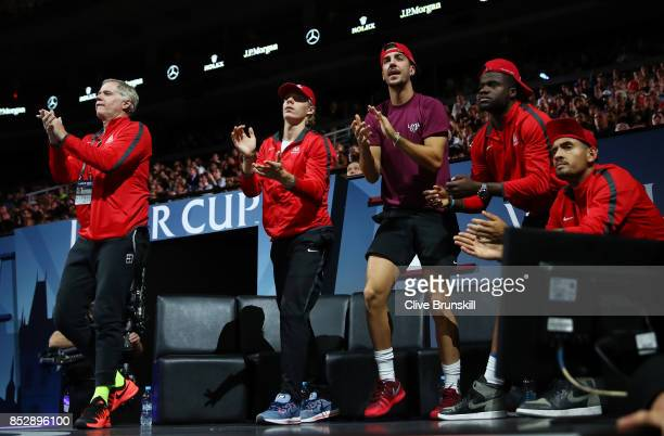 Peter Mcenroe Denis Shapovalov Thanasi Kokkinakis Frances Tiafoe and Nick Kyrgios of Team World applaud as John Isner and Jack Sock of Team World...