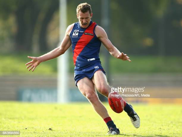 Peter Mcevoy of Coburg kicks during the round five VFL match between Coburg and Sandringham at Pirhana Park on May 14 2017 in Melbourne Australia