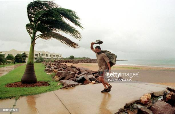 Peter McGrath braves strong winds as Cyclone Thelma approaches Darwin 08 December Thelma has as much force as Cyclone Tracey which destroyed the city...
