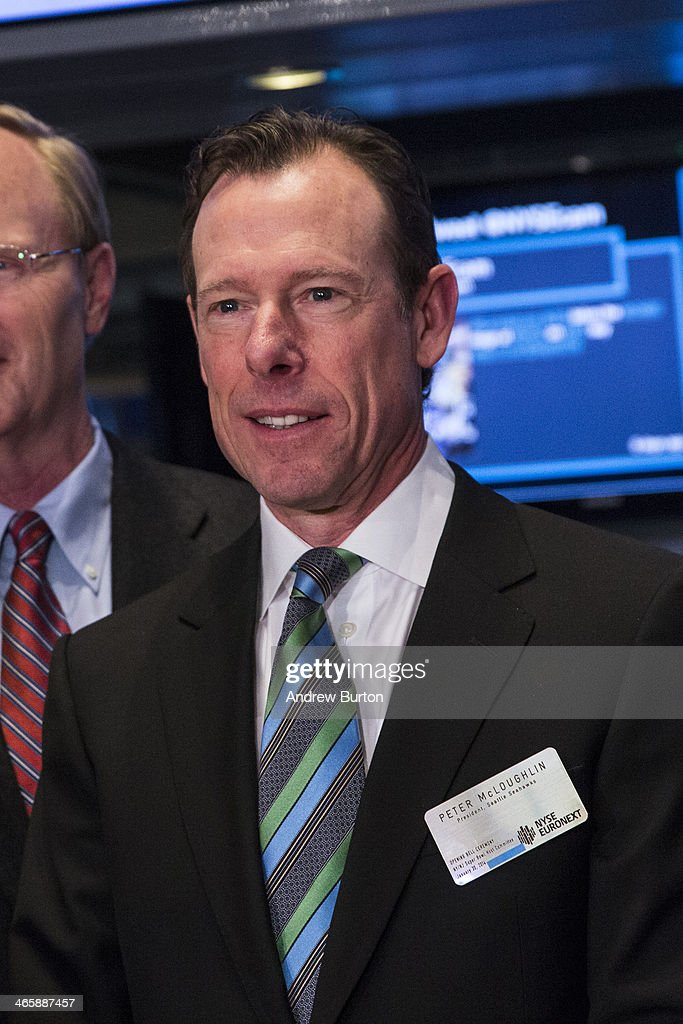 Peter McLoughlin, president of the Seattle Seahawks, arrives on the floor of the New York Stock Exchange (NYSE) on the morning of January 30, 2014 in New York City. The NYSE welcomed members of the Super Bowl Host Committee, owners and managers of the Denver Broncos and Seattle Seahawks to ring the opening bell today.