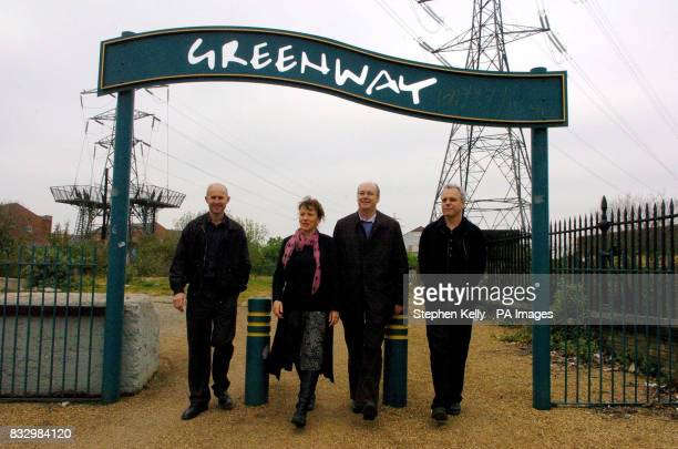 Peter Mitchell Elizabeth Adams Jerome Frost and Graeme Sutherland pose in front of the entrance to Greenway in Stratford east London