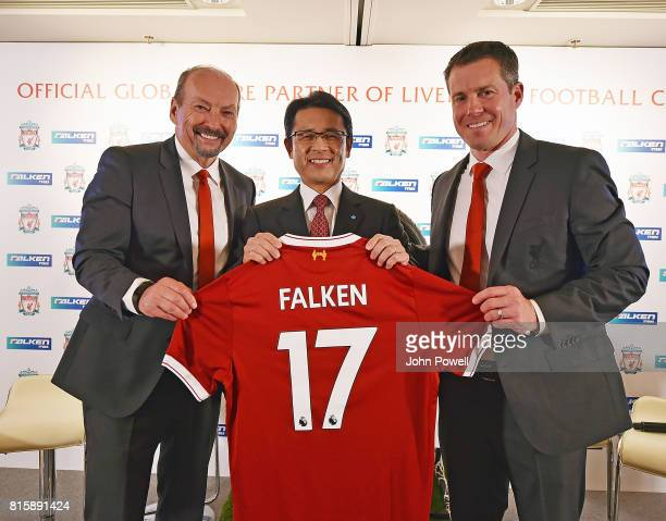 Peter Moore CEO of Liverpool and Billy Hogan Cheif Comercial Officer of Liverpool give a shirt to Saturo Yamatomo Director and Senior Executive of...