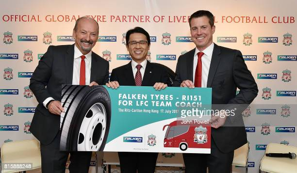 Peter Moore CEO of Liverpool and Billy Hogan Cheif Commercial Officer of Liverpool accept a gift of free tyres for the LFC coach for one year from...