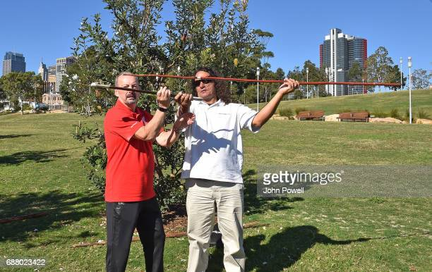 Peter Moore CEO of Liverpool is shown how to throw the Gulka by Clarence Slockee during a Aboriginal culture tour on Walumil Lawn on May 25 2017 in...
