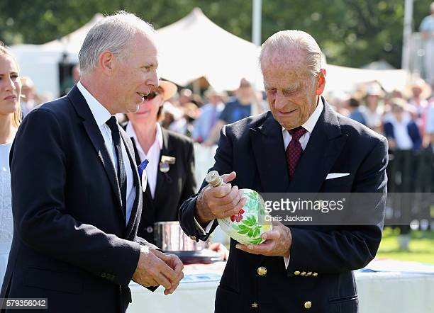 Peter Moore Global Prestige Brand Director of Royal Salute and Prince Philip Duke of Edinburgh attend the Royal Salute Coronation Cup at Guards Polo...