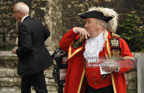 Peter Moore the Town Crier of Westminster waits for the last coin operated parking meter in central London to be removed from Warwick Square in...