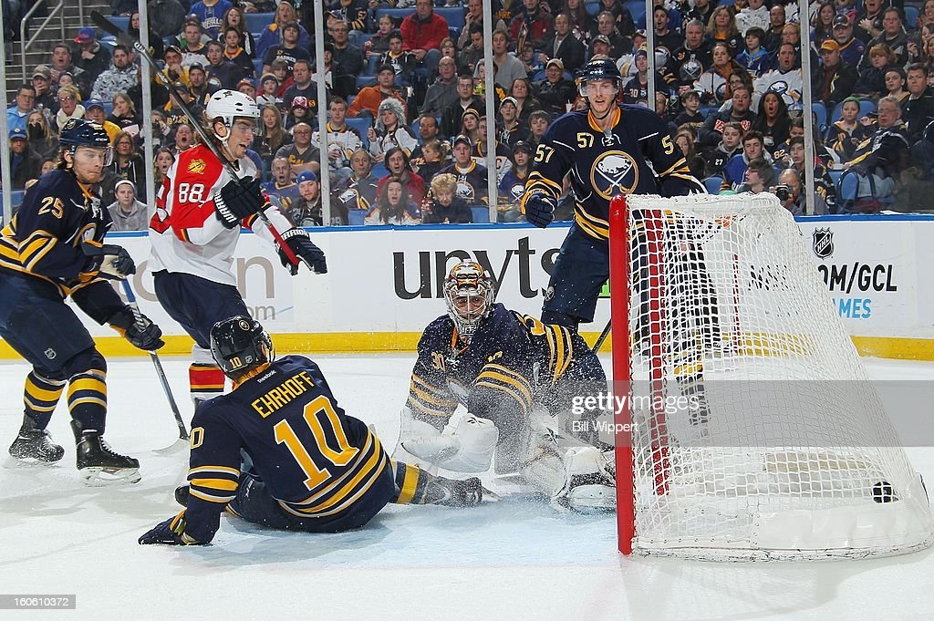 Peter Mueller #88 of the Florida Panthers scores a second period goal next to Ryan Miller #30 and Christian Ehrhoff #10 of the Buffalo Sabres on February 3, 2013 at the First Niagara Center in Buffalo, New York.