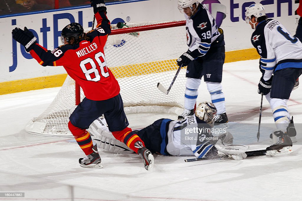 Peter Mueller #88 of the Florida Panthers shoots and scores against Goaltender <a gi-track='captionPersonalityLinkClicked' href=/galleries/search?phrase=Ondrej+Pavelec&family=editorial&specificpeople=3644118 ng-click='$event.stopPropagation()'>Ondrej Pavelec</a> #31of the Winnipeg Jets at the BB&T Center on January 31, 2013 in Sunrise, Florida.