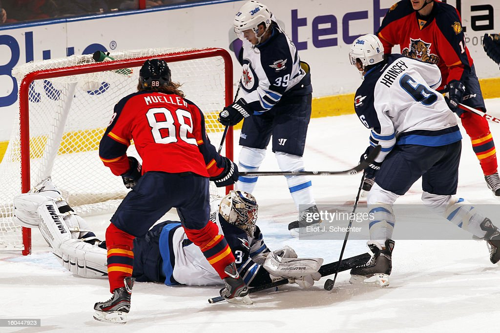Peter Mueller #88 of the Florida Panthers shoots and scores against Goaltender Ondrej Pavelec #31of the Winnipeg Jets at the BB&T Center on January 31, 2013 in Sunrise, Florida.