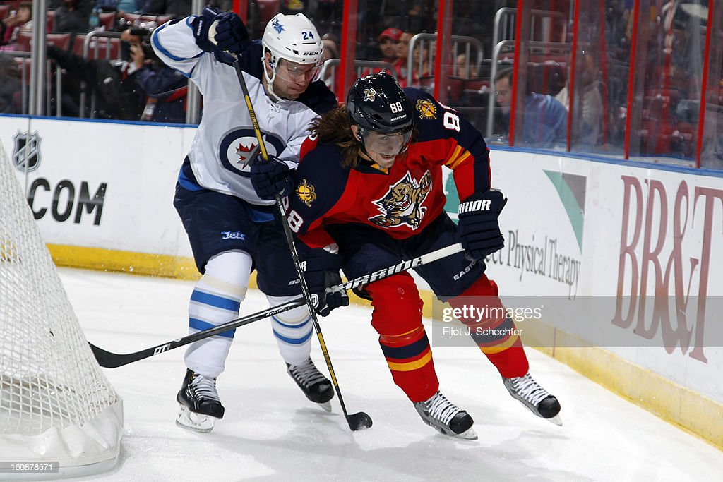 Peter Mueller #88 of the Florida Panthers skates for possession against Grant Clitsome #24 of the Winnipeg Jets at the BB&T Center on January 31, 2013 in Sunrise, Florida.