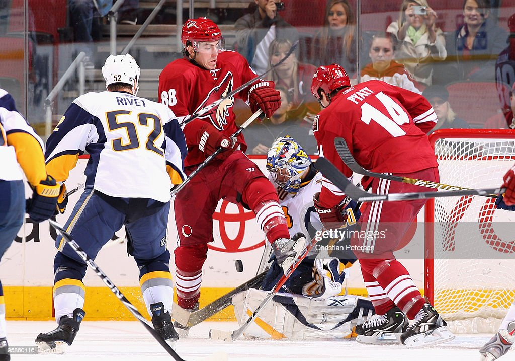 Peter Mueller #88 of the Phoenix Coyotes attempts to screen the goaltender as a shot comes in on <a gi-track='captionPersonalityLinkClicked' href=/galleries/search?phrase=Ryan+Miller+-+Ice+Hockey+Player&family=editorial&specificpeople=206960 ng-click='$event.stopPropagation()'>Ryan Miller</a> #30 of the Buffalo Sabres during the third period of the NHL game at Jobing.com Arena on January 18, 2010 in Glendale, Arizona. The Sabres defeated the Coyotes 7-2.