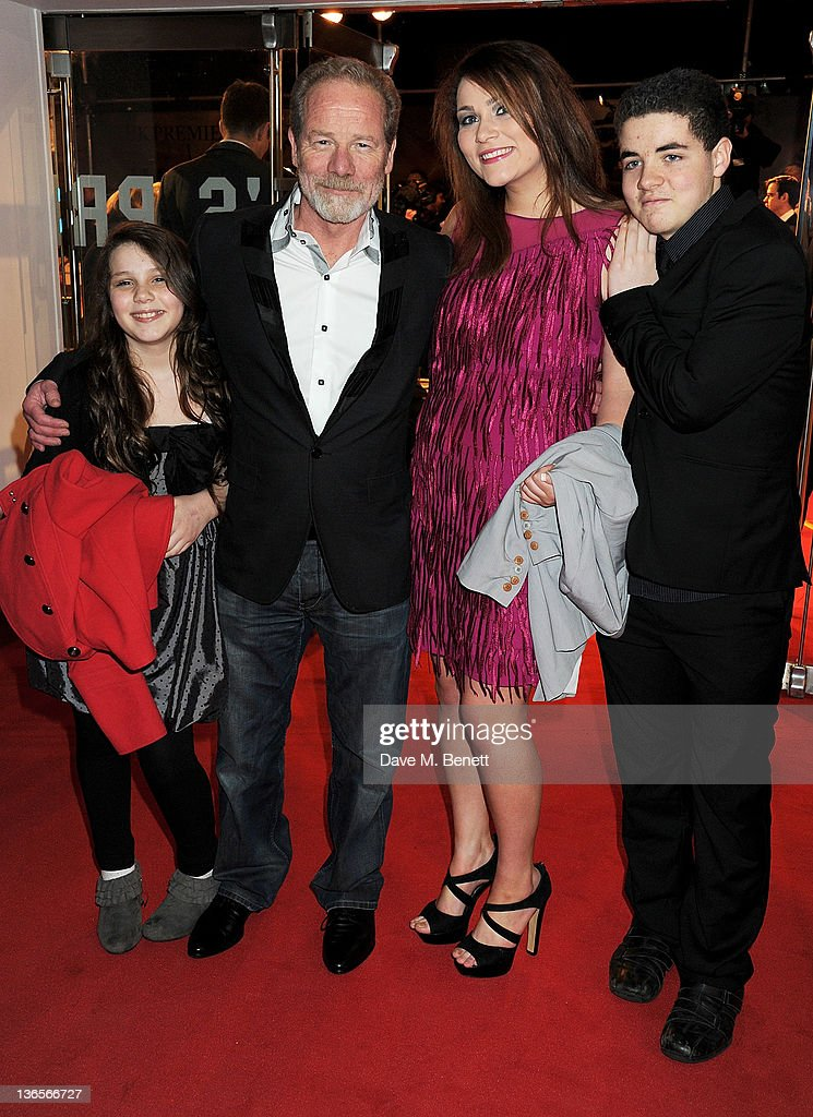Peter Mullan (2L) arrives at the UK Premiere of 'War Horse' at Odeon Leicester Square on January 8, 2012 in London, England.