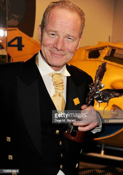 Peter Mullen director of best film winner 'Neds' poses with his award at the London Evening Standard British Film Awards 2011 at the London Film...