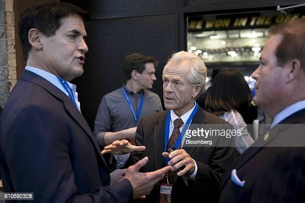 Peter Navarro senior economic advisor to 2016 Republican Presidential Nominee Donald Trump center speaks with Mark Cuban billionaire owner of the...
