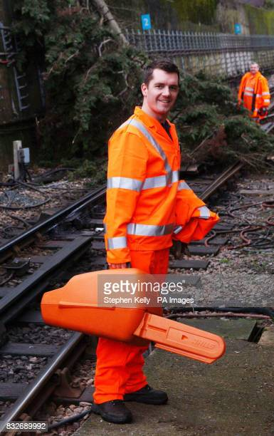 Peter Neal of London Underground's Emergency Response Unit prepares to remove an uprooted tree that obstructed the track at Colindale Underground...