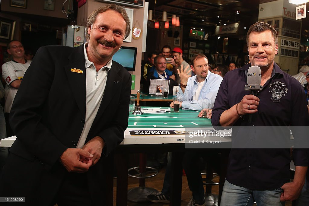 Peter Neururer expert of Sport 1 Bitburger Fantalk and Thomas Helmer moderator of Sport 1 Bitburger Fantalk pose at Sport 1 Fan Talk at 11 Freunde...