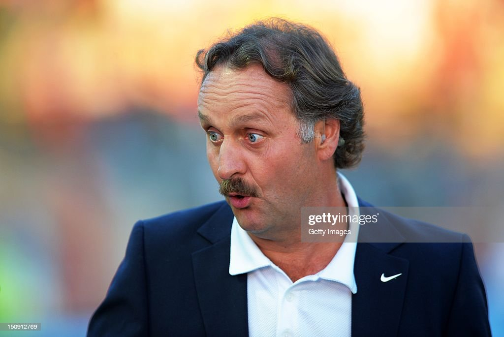 Peter Neururer reacts prior to the during the Second Bundesliga match between Erzgebirge Aue and 1 FC Koeln at Erzgebirgs Stadium on August 27 2012...