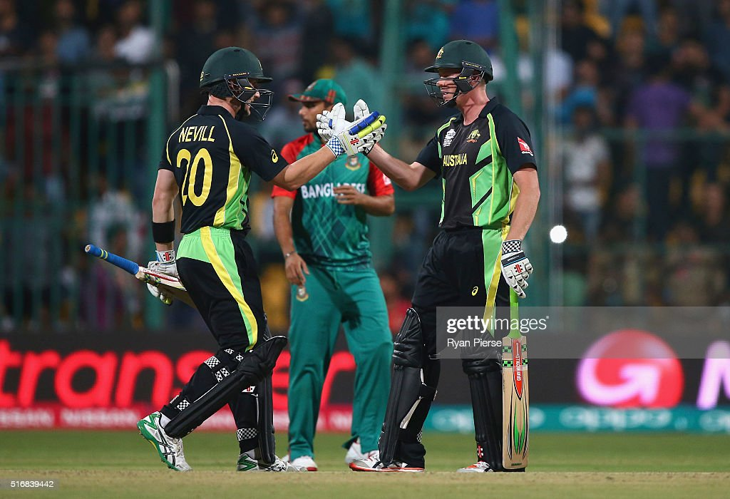 Peter Nevill and James Faulkner of Australia celebrate after Faulkner hit the winning runs during the ICC World Twenty20 India 2016 Super 10s Group 2 match between Australia and Bangladesh at M. Chinnaswamy Stadium on March 21, 2016 in Bangalore, India.
