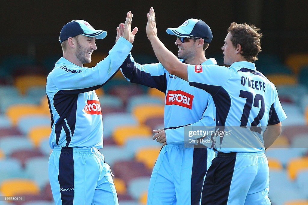 Peter Nevill and Stephen O'Keefe of the Blues celebrate after combining to dismiss Chris Lynn of the Bulls during the Ryobi One Day Cup match between the Queensland Bulls and the New South Wales Blues at The Gabba on November 21, 2012 in Brisbane, Australia.