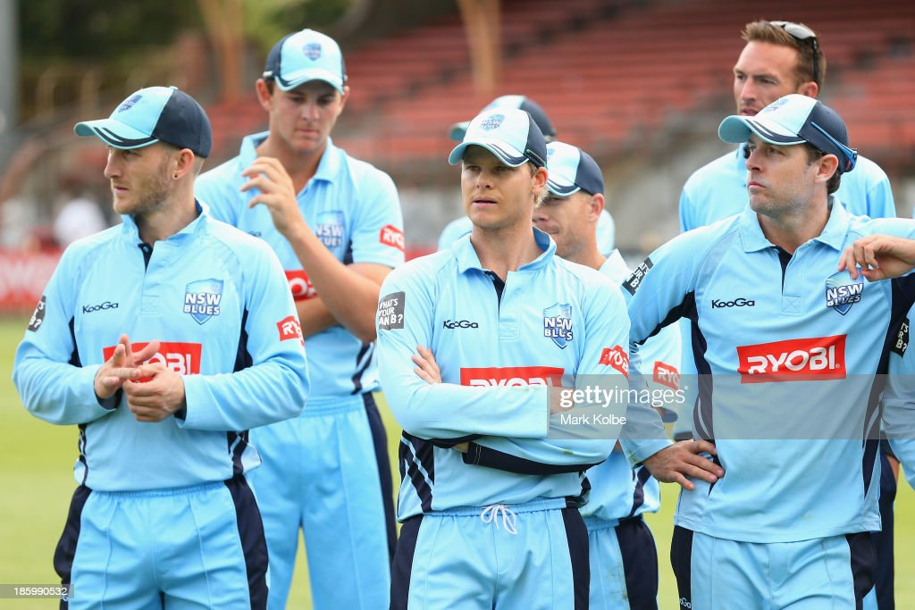 Peter Nevill, Josh Hazellwood, Steve Smith, David Warner and Ben Rohrer of the Blues look dejected after defeat during the Ryobi Cup Final match between the Queensland Bulls and the New South Wales Blues at North Sydney Oval on October 27, 2013 in Sydney, Australia.