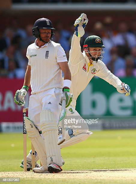 Peter Nevill of Australia celebrates after Shaun Marsh of Australia took a catch to dismiss Ian Bell of England off the bowling of Nathan Lyon of...