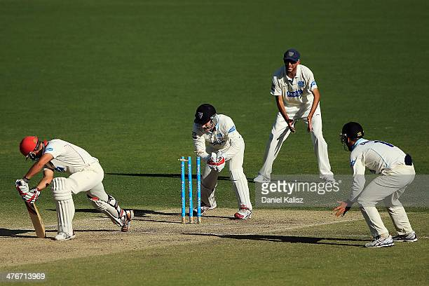 Peter Nevill of the Blues attempts a stumping to Sam Rapheal of the Redbacks during day three of the Sheffield Shield match between South Australia...