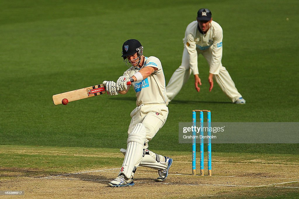 Peter Nevill of the Blues (L) bats during day three of the Sheffield Shield match between the Victorian Bushrangers and the New South Wales Blues at Melbourne Cricket Ground on March 9, 2013 in Melbourne, Australia.