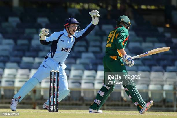 Peter Nevill of the Blues takes a catch to dismiss Ben Dunk of the Tigers from the bowling of Nathan Lyon of the Blues during the One Day Cup match...
