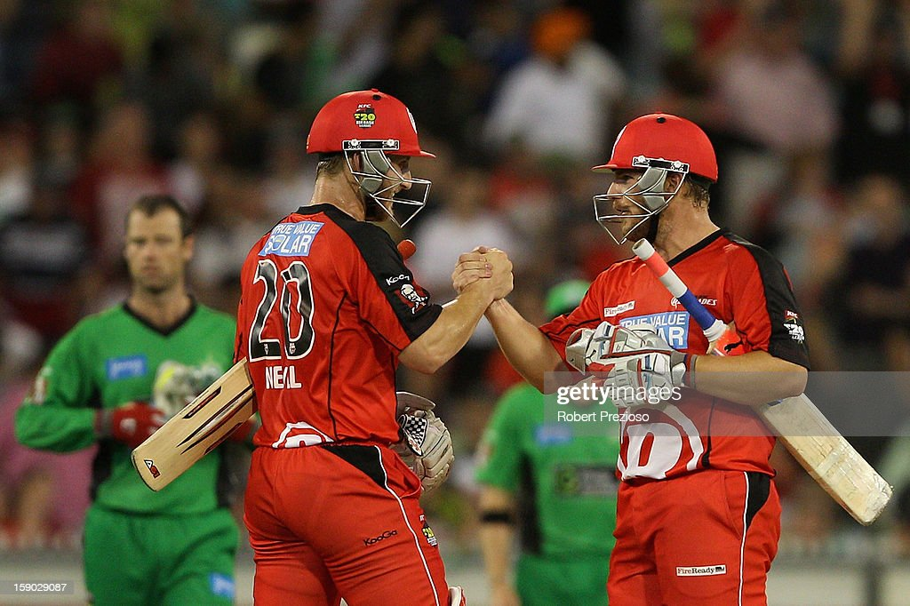 Peter Nevill of the Renegades and <a gi-track='captionPersonalityLinkClicked' href=/galleries/search?phrase=Aaron+Finch+-+Cricket+Player&family=editorial&specificpeople=724040 ng-click='$event.stopPropagation()'>Aaron Finch</a> of the Renegades celebrate a win during the Big Bash League match between the Melbourne Stars and the Melbourne Renegades at Melbourne Cricket Ground on January 6, 2013 in Melbourne, Australia.