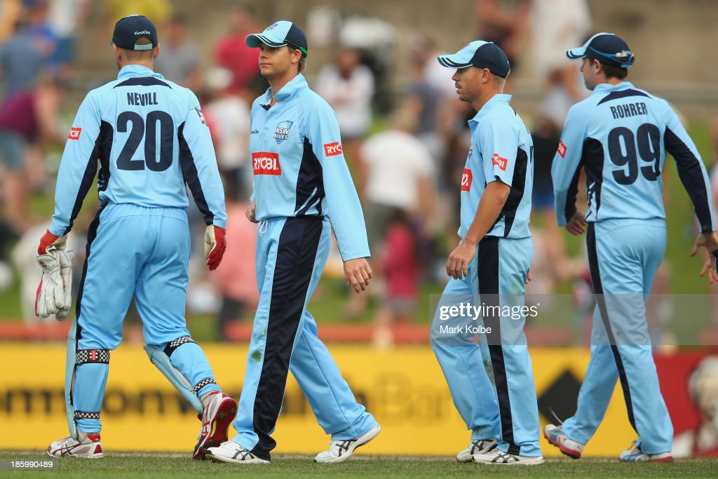 Peter Nevill, Steve Smith, David Warner and Ben Rohrer of the Blues look dejected after defeat during the Ryobi Cup Final match between the Queensland Bulls and the New South Wales Blues at North Sydney Oval on October 27, 2013 in Sydney, Australia.