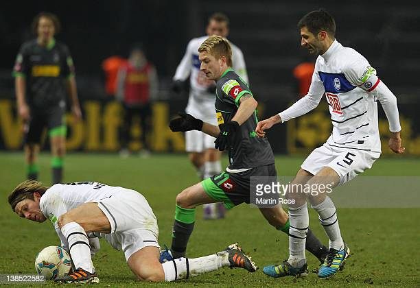 Peter Niemeyer of Berlin and Marco Reus of Moenchengladbach battle for the ball during the DFB Cup Quarter Final match between Hertha BSC Berlin and...