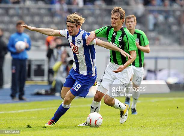 Peter Niemeyer of Berlin battles for the ball with Kai Buelow of Muenchen during the Second Bundesliga match between Hertha BSC Berlin and TSV 1860...