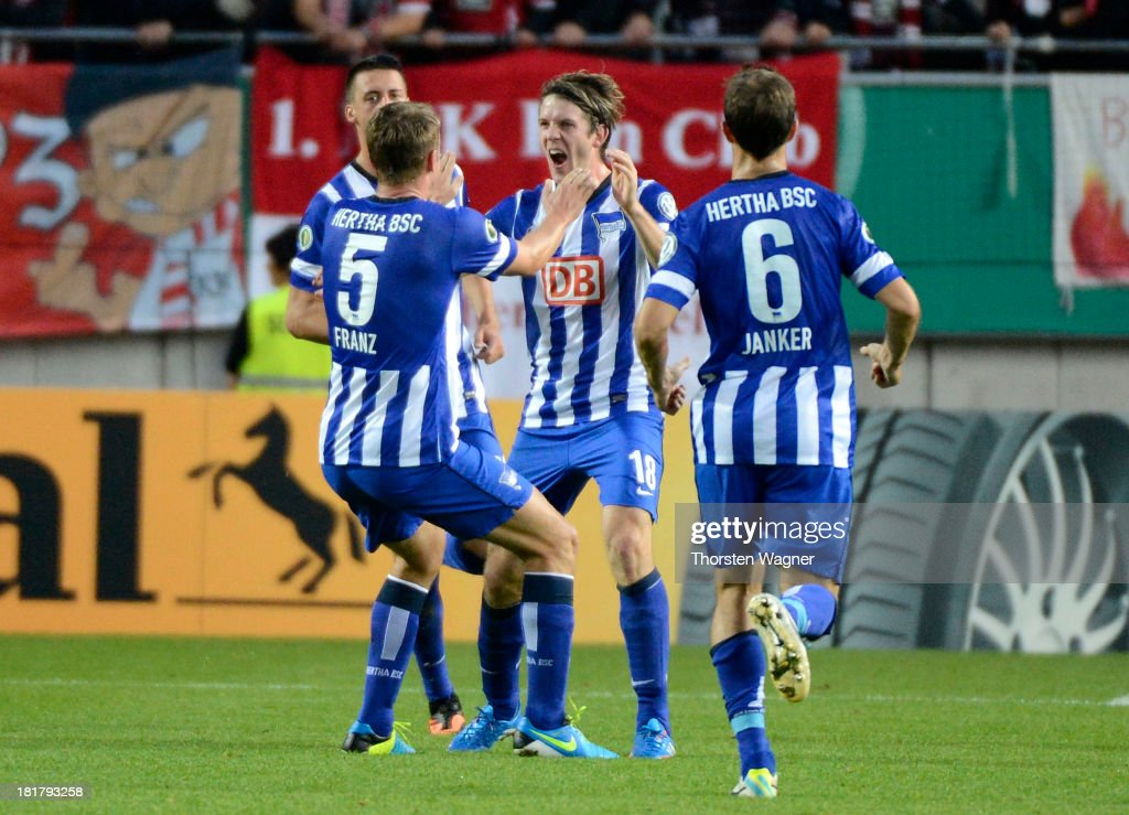 <a gi-track='captionPersonalityLinkClicked' href=/galleries/search?phrase=Peter+Niemeyer&family=editorial&specificpeople=605402 ng-click='$event.stopPropagation()'>Peter Niemeyer</a> of Berlin celebrates after scoring his teams opening goal during the DFB Cup 2nd round match between 1.FC Kaiserslautern and Hertha BSC Berlin at Fritz-Walter-Stadion on September 25, 2013 in Kaiserslautern, Germany.